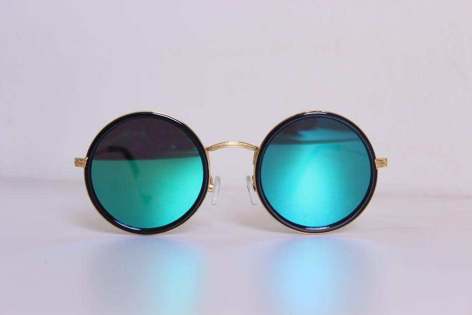360 eyecare - toronto optometrist - pair of blue tinted sunglasses