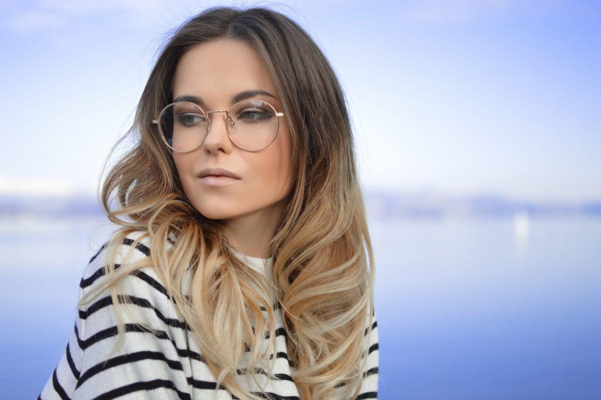 360 eyecare - toronto optometry clinic - woman wearing custom glasses